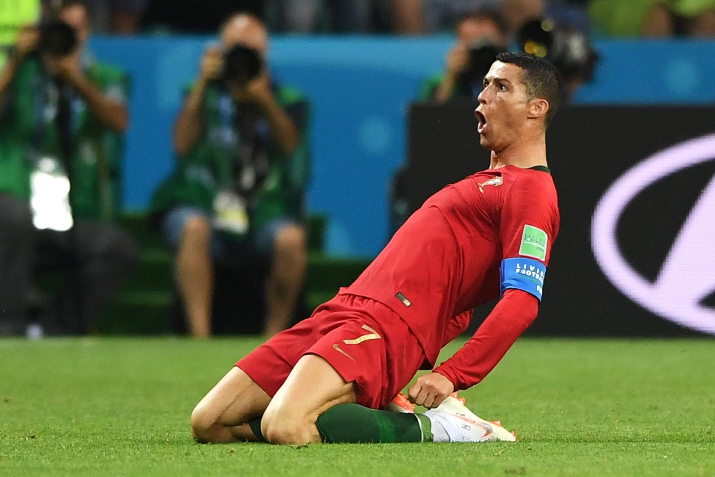 Ronaldo magic denies Spain in six-goal thriller