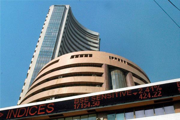 Profit booking, weak data depress equity indices