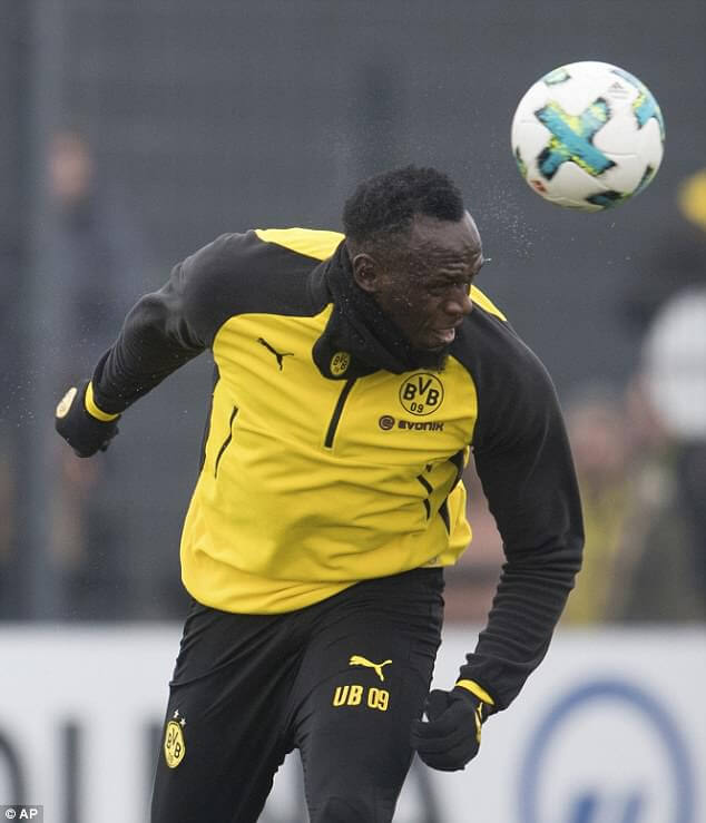 Bolt continues pursuit of professional football career