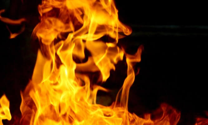Man allegedly sets wife ablaze