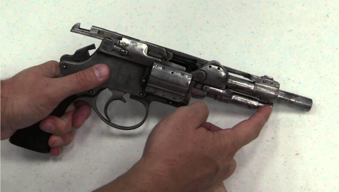 One held with hand-made revolver