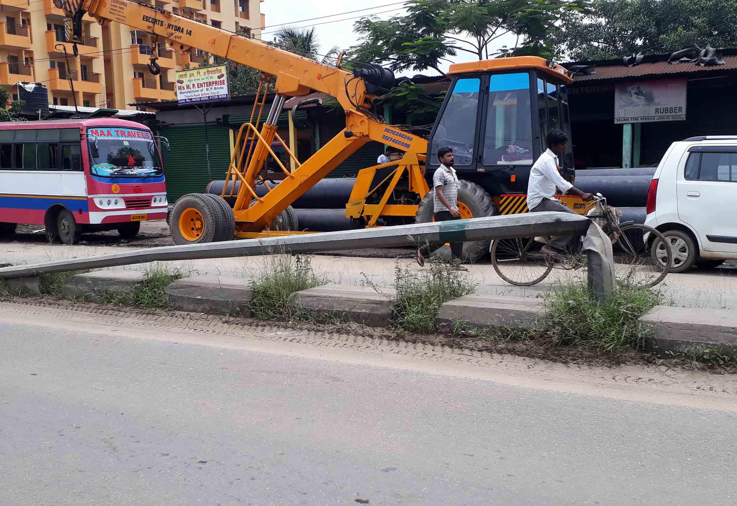 Power pole lying abandoned for years at NH-37 near Guwahati