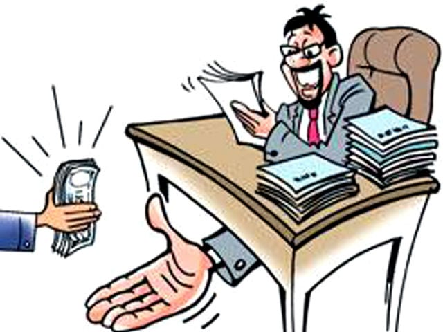 Lat Mandal of Kaliabor circle caught red handed while taking bribe