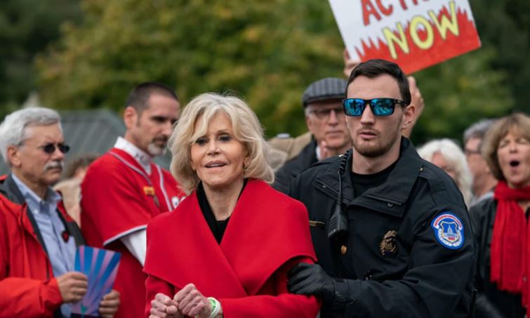 Jane Fonda accepts Bafta award during arrest at climate protest