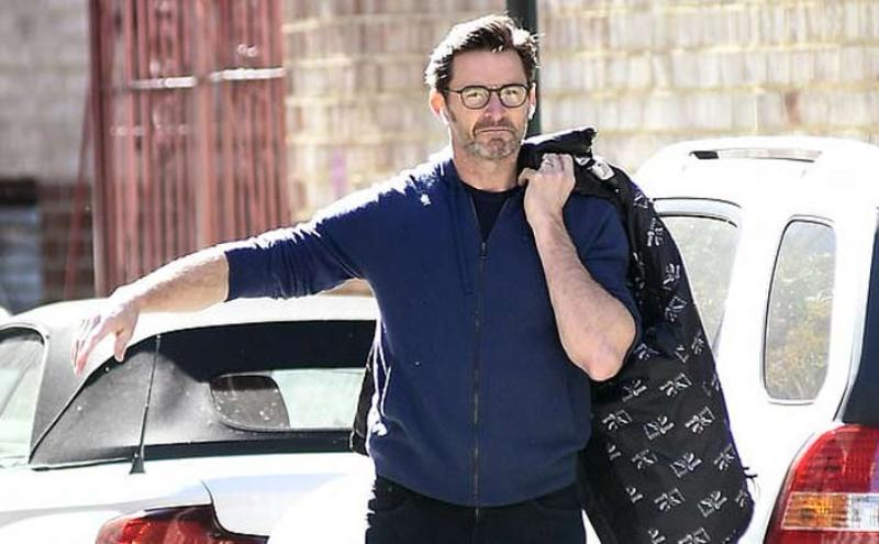 Hugh Jackman spotted hailing a cab in New York