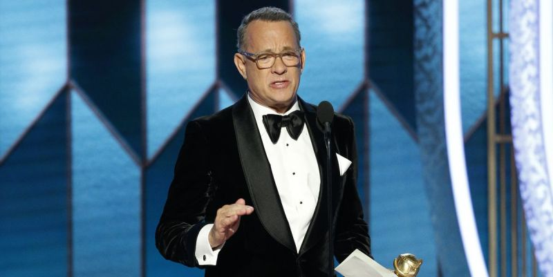 Actor Tom Hanks has a tearful moment on stage at the Golden Globe