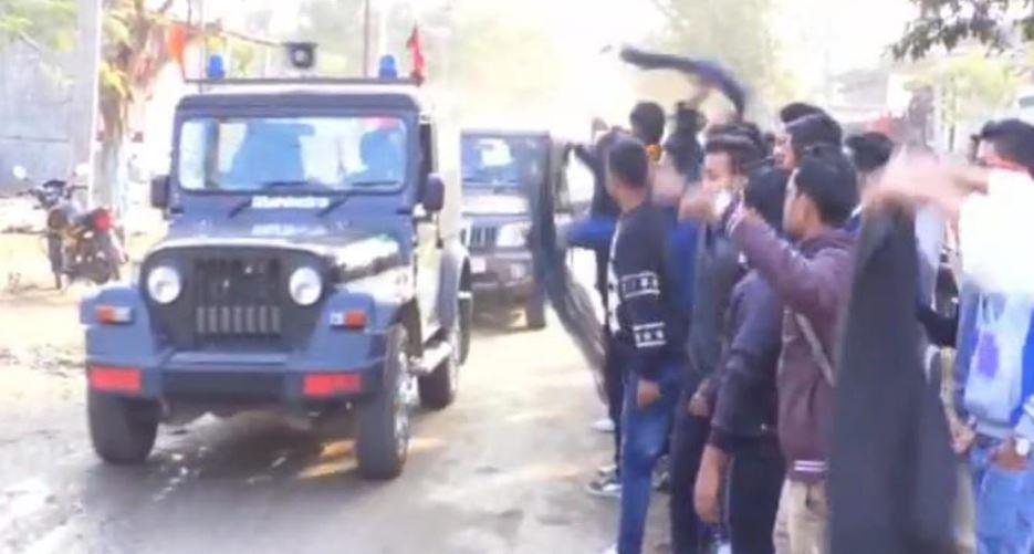 AASU activists show black flags to Minister Pijush Hazarika in Sarupathar