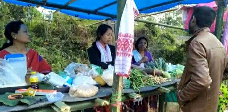 Villagers sell garden-produced items in stalls along roadside in Tinsukia