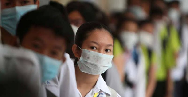 China bans foreign visitors after imported coronavirus cases rise