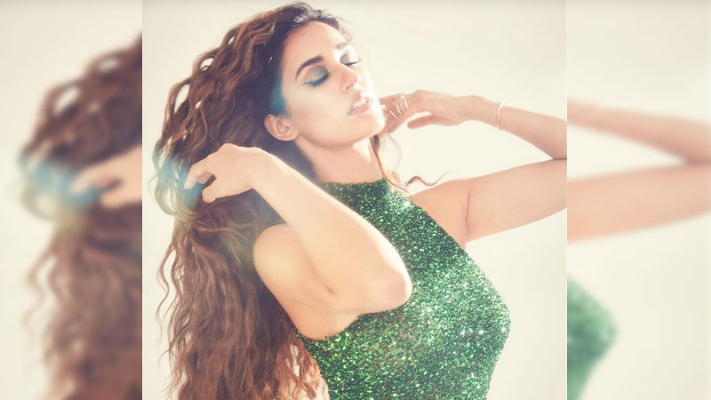 Disha Patani looks a late Christmas gift in this shimmery green gown