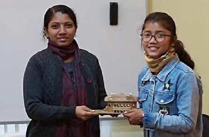 Sivasagar DC Dr MS Lakshmi Priya felicitates Dhriti Phukan