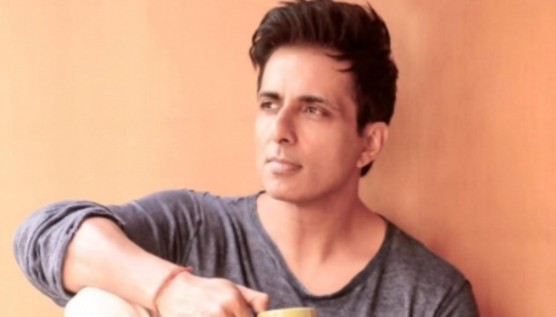 Actor Sonu Sood distributes food among the underprivileged