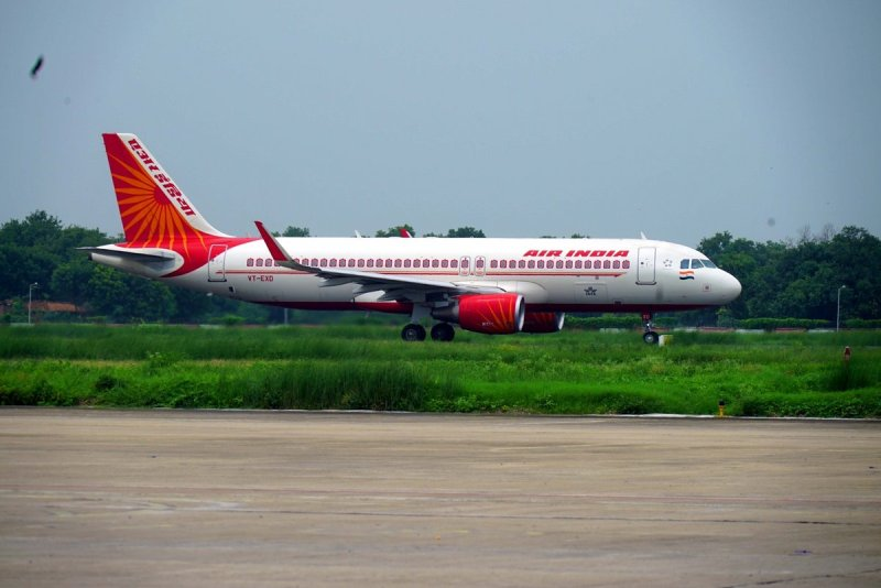 air india passenger among 118 onboard tests positive for