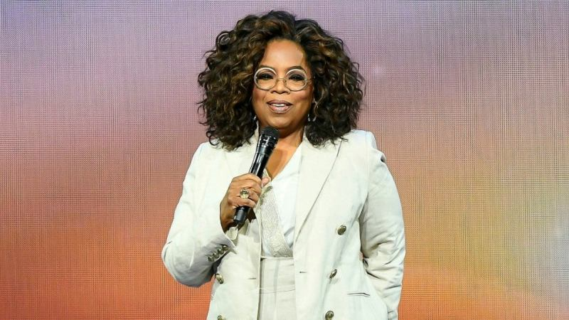 Oprah Winfrey falls on stage while talking about balance