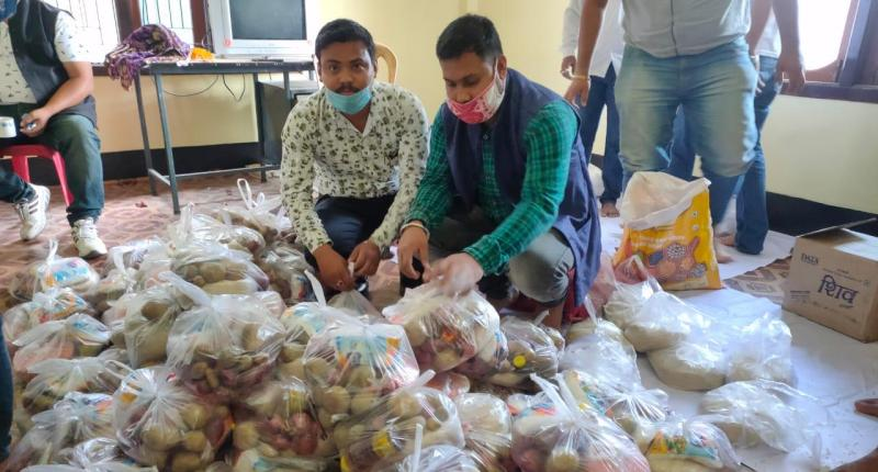 All Assam Students' Union (AASU) members distribute food items across Lakhimpur