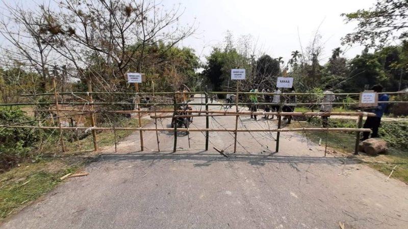 Morigaon People put up temporary bamboo barricades